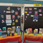 Mt Roskill Grammar School display of rainbow materials with black sign background featuring posters